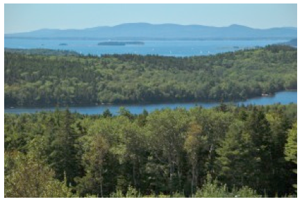 View from Caterpillar Hill of our lake – Walker Pond – in the foreground with the Penobscot Bay and the Camden Hills in the distance.